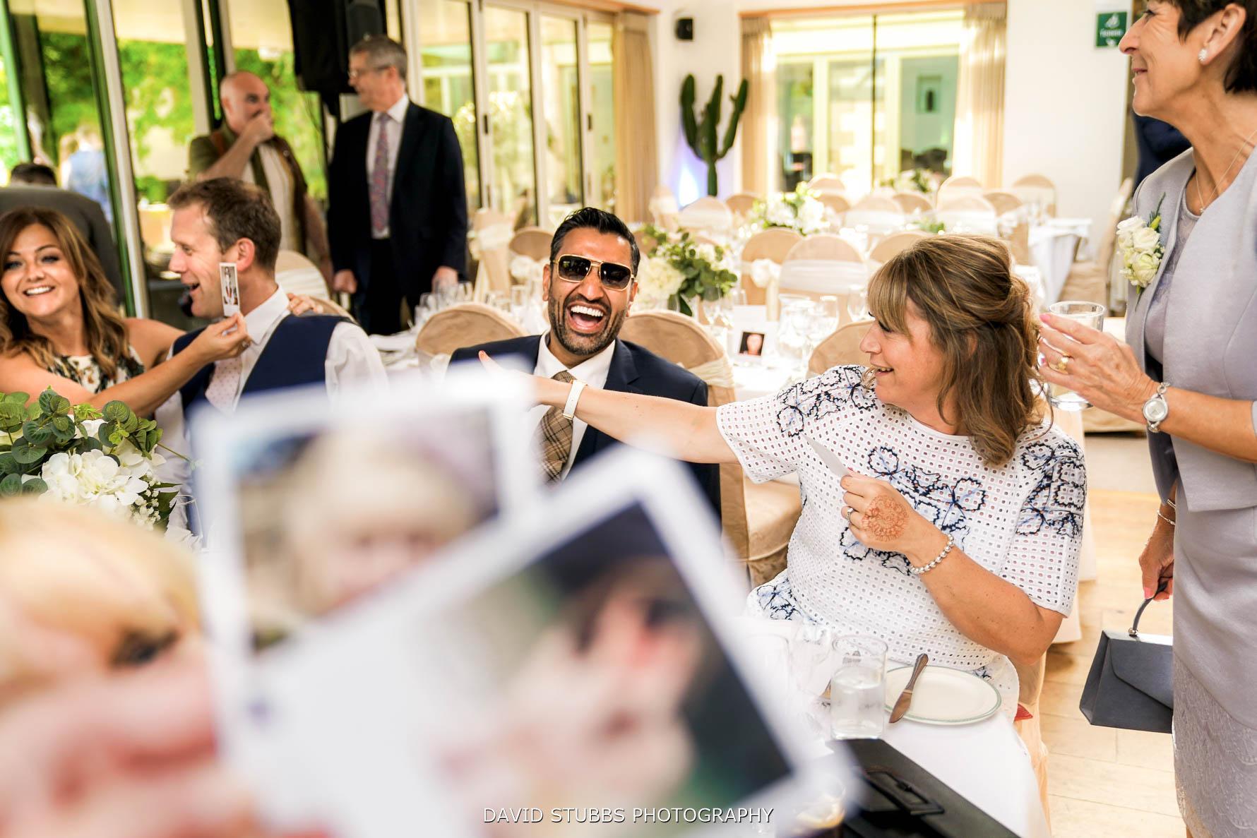 reaction to polaroid potos on tables