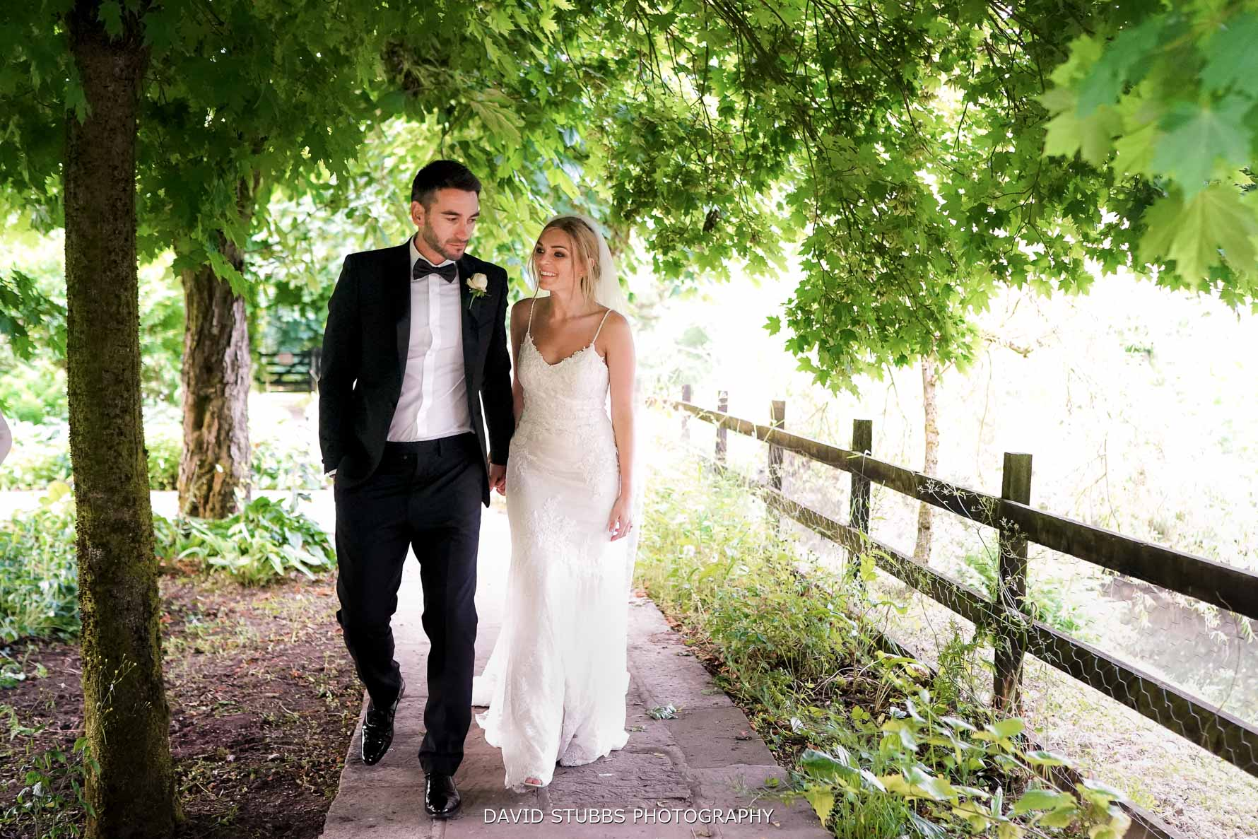 bride and groom walking naturally together