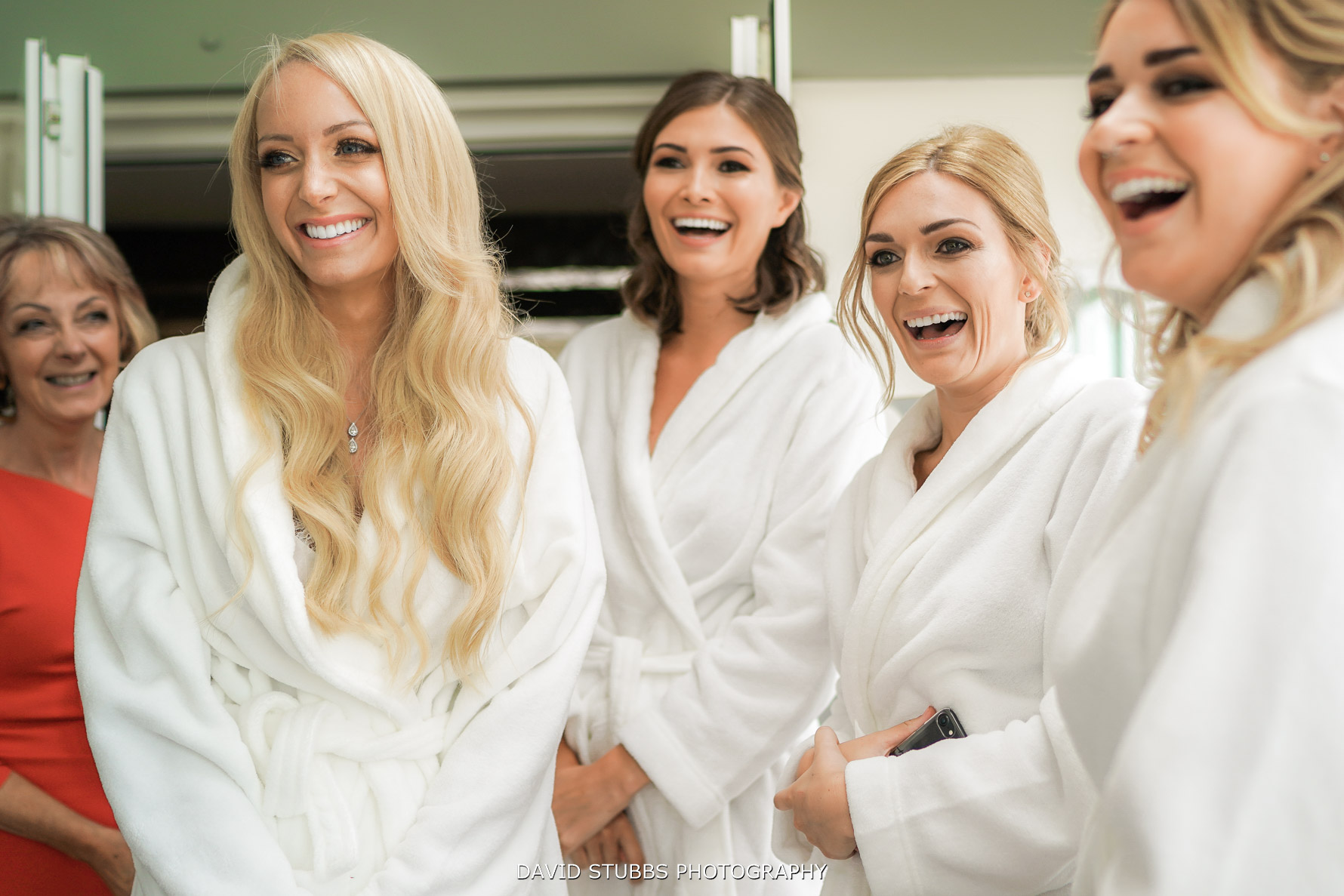 bridesmaids laughing and celebrating the wedding