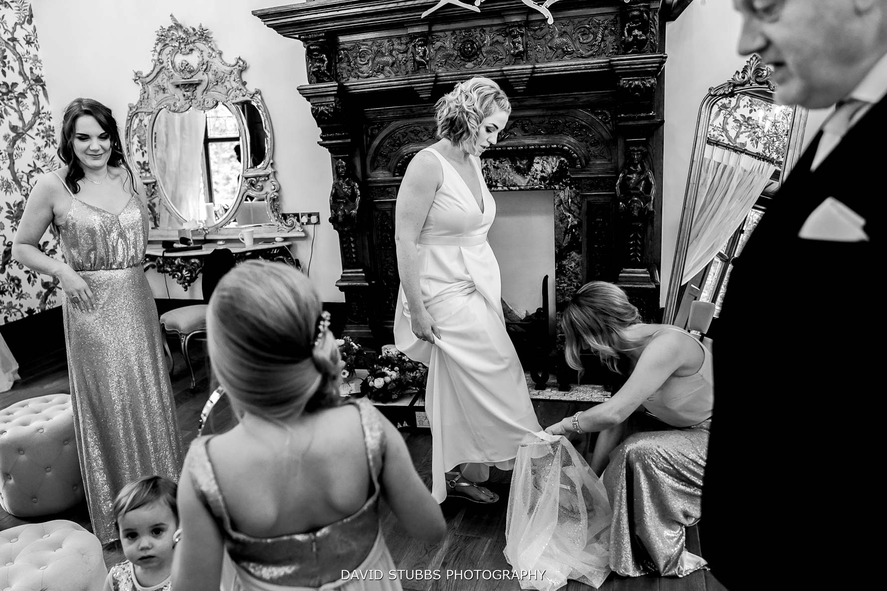 wedding gown now being put on