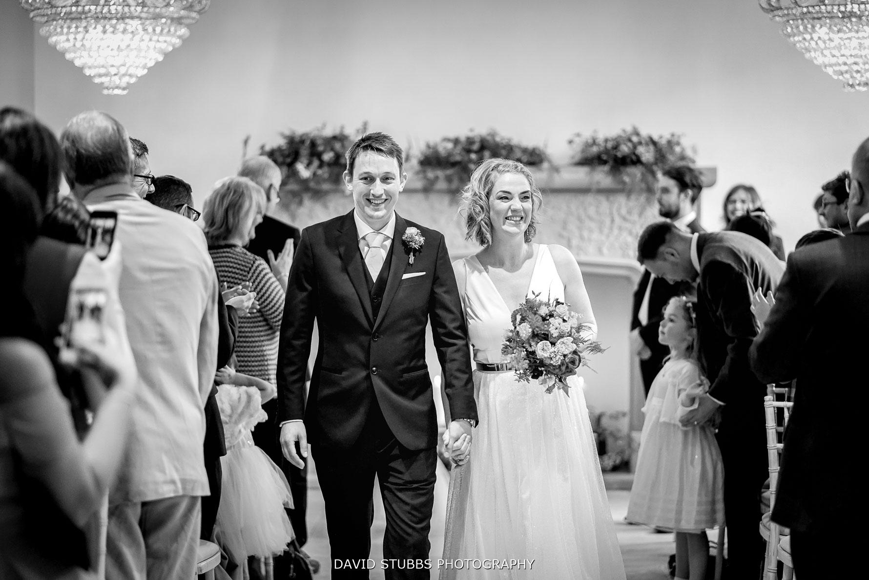 just married, they walk down the isle for their Tyn Dwr hall wedding