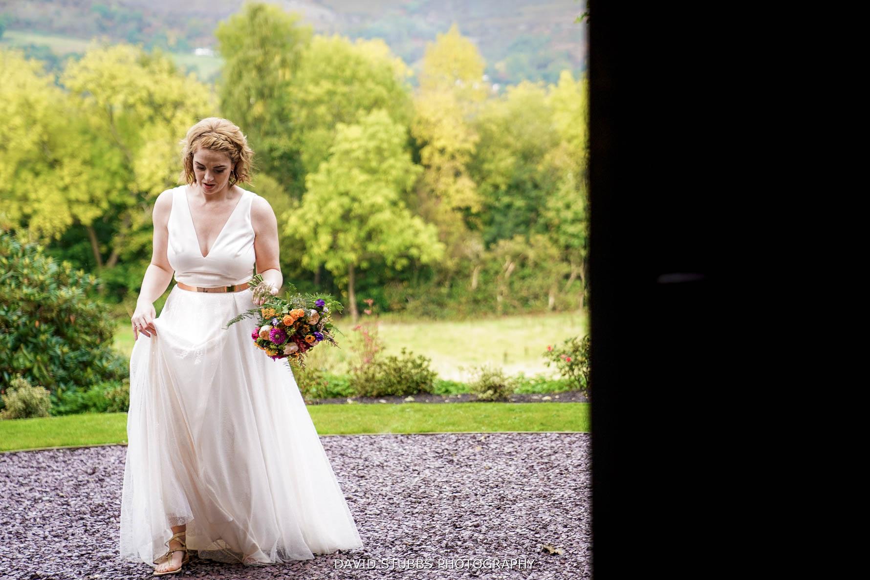 bride photographed through the doorway