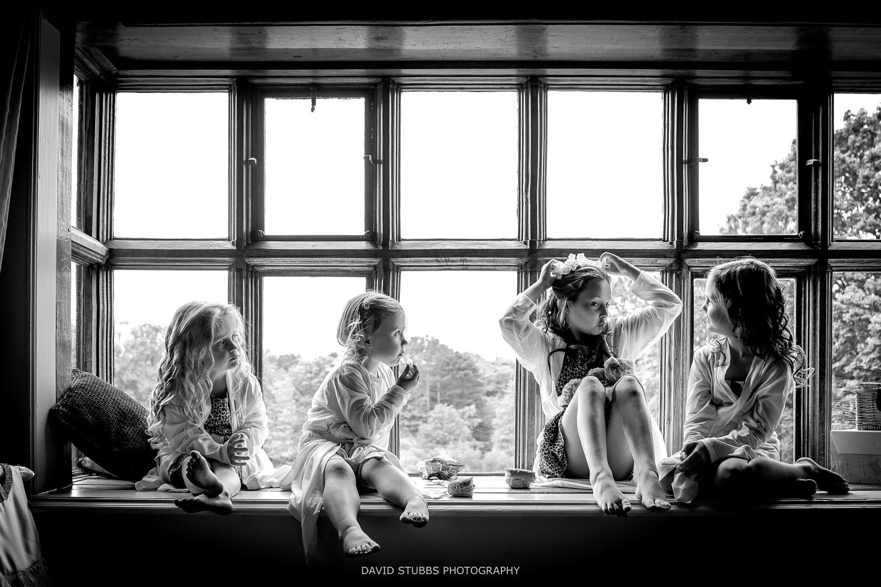 photo of all the bridemaids together in the window light