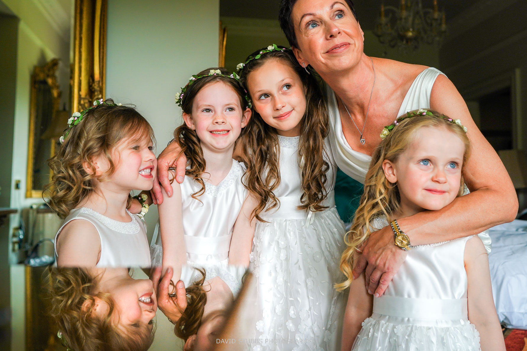 all the bridal party together being photographed