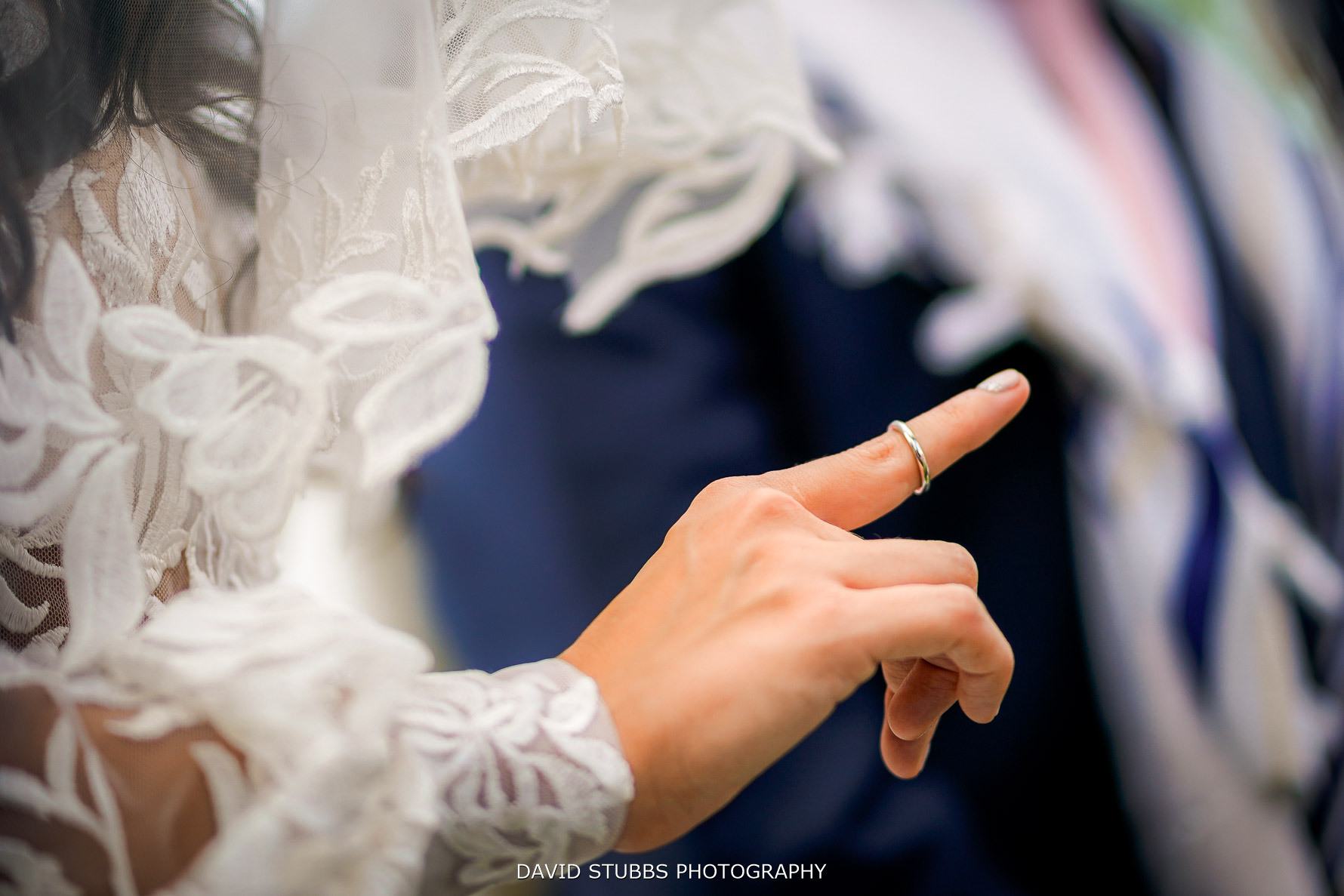 wedding ring being put on her finger