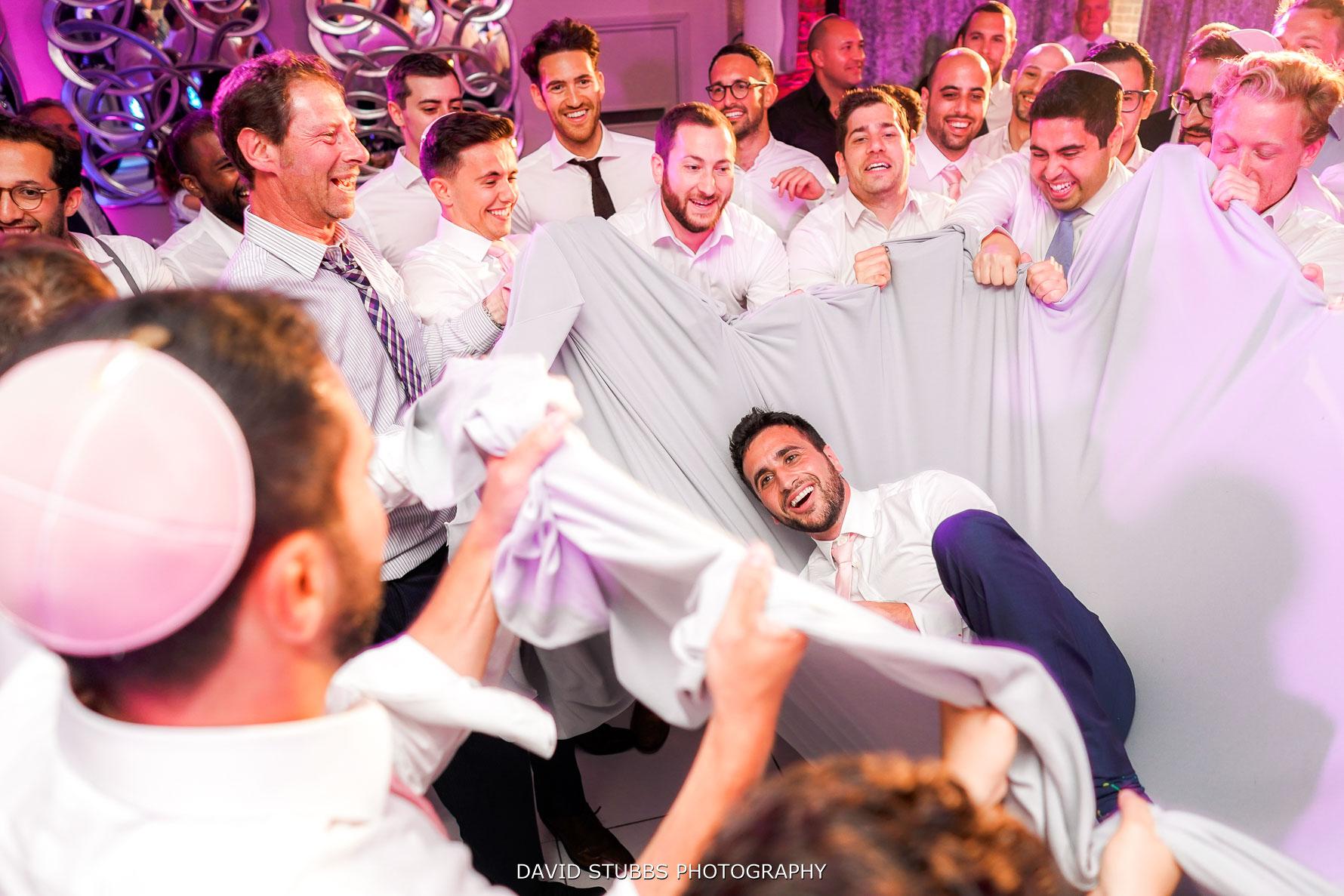 groom in a sheet at wedding