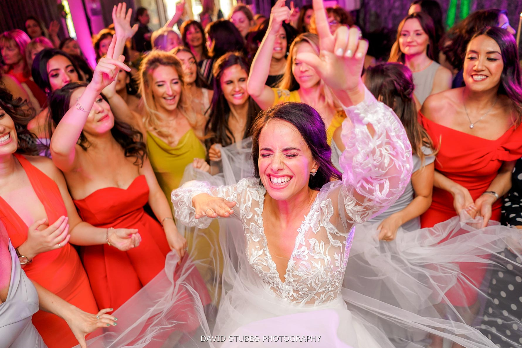 bride and her friends dancing