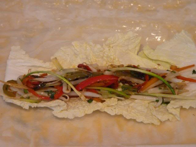 Then add a portion of the mixed vegetables on top of the Cabbage Leaves.