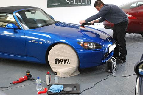 Polishing a blue car