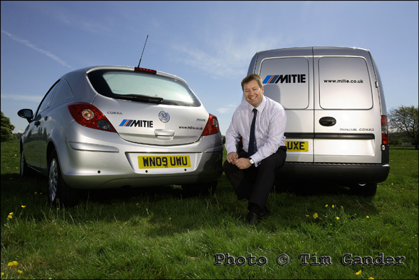 mitie services vehicles in a field