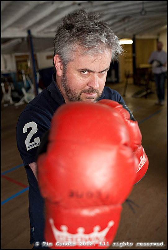 David Evans of Ghost Limited tries a pair of boxing gloves in the former Frome Amateur Boxing club building