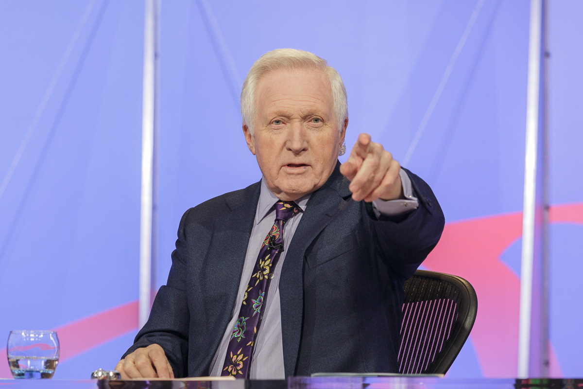 David Dimbleby chairs BBC Question Time, filmed at University of Bath. He points to the audience to take the next question.