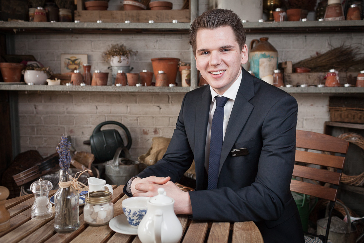 Alex Leese of Bath store Jolly's relaxes in his favourite cafe which features rustic artefacts in the decor.
