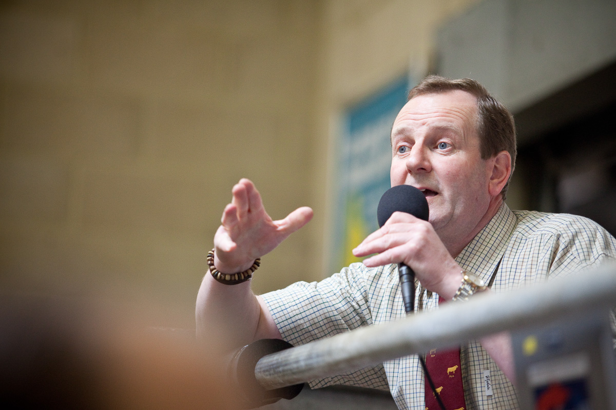 An auctioneer takes bids at Standerwick Livestock Market, Frome, UK.