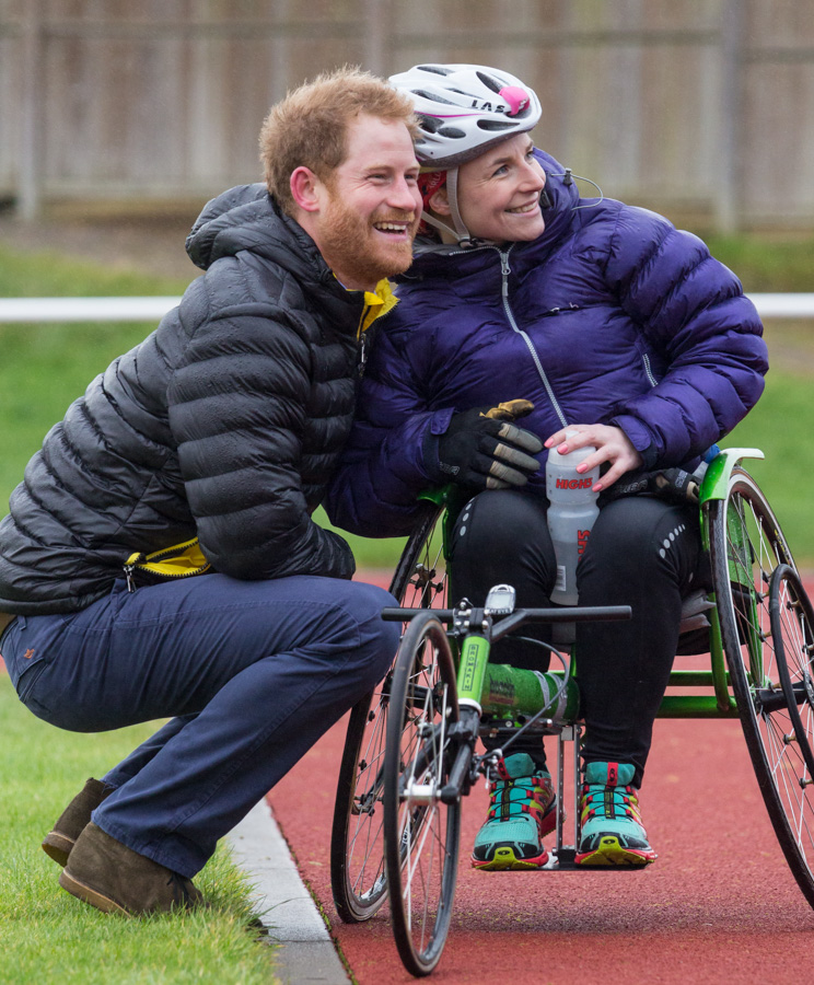 Prince Harry meeting a female Invictus athlete at University of Bath Sports Training Village.