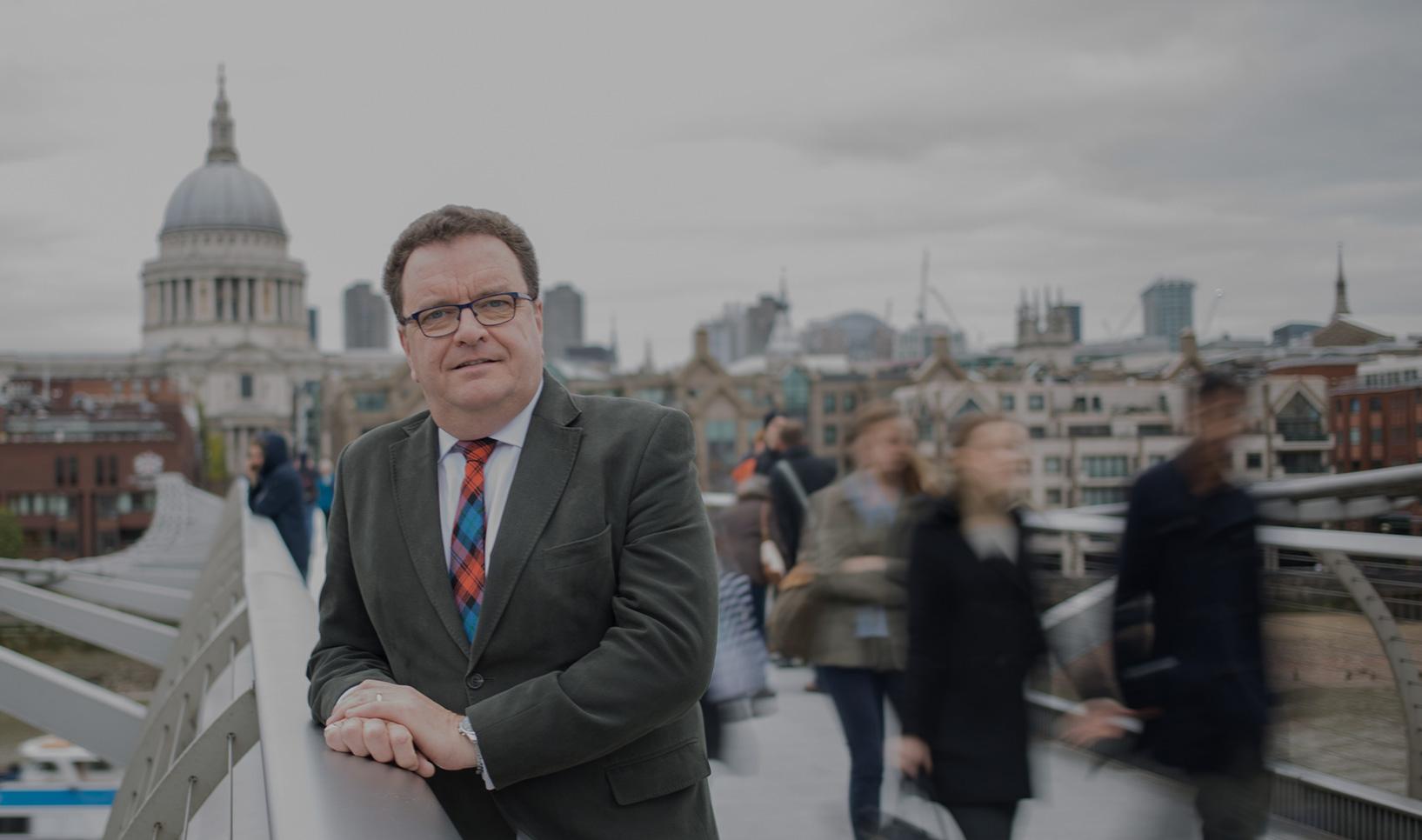 Image from Briscoe French PR website showing Kevin Briscoe on Millennium Bridge, London, UK