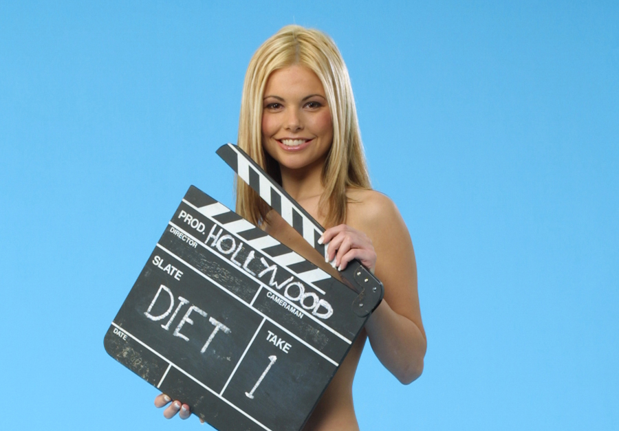 Jakki Degg poses with movie clapper board