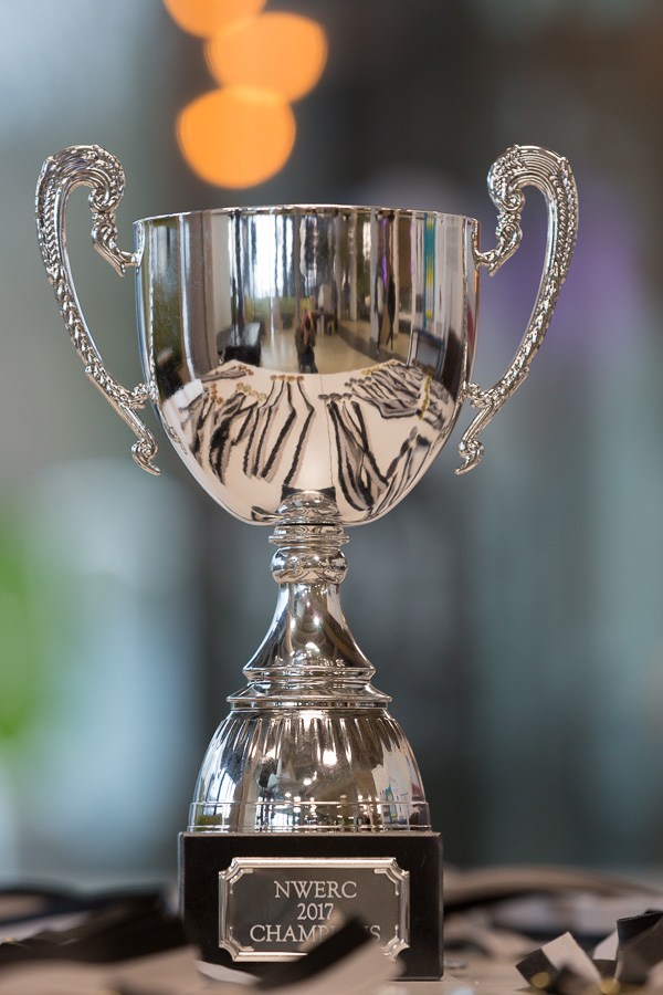 A silver trophy sits on a table awaiting the prize-giving.