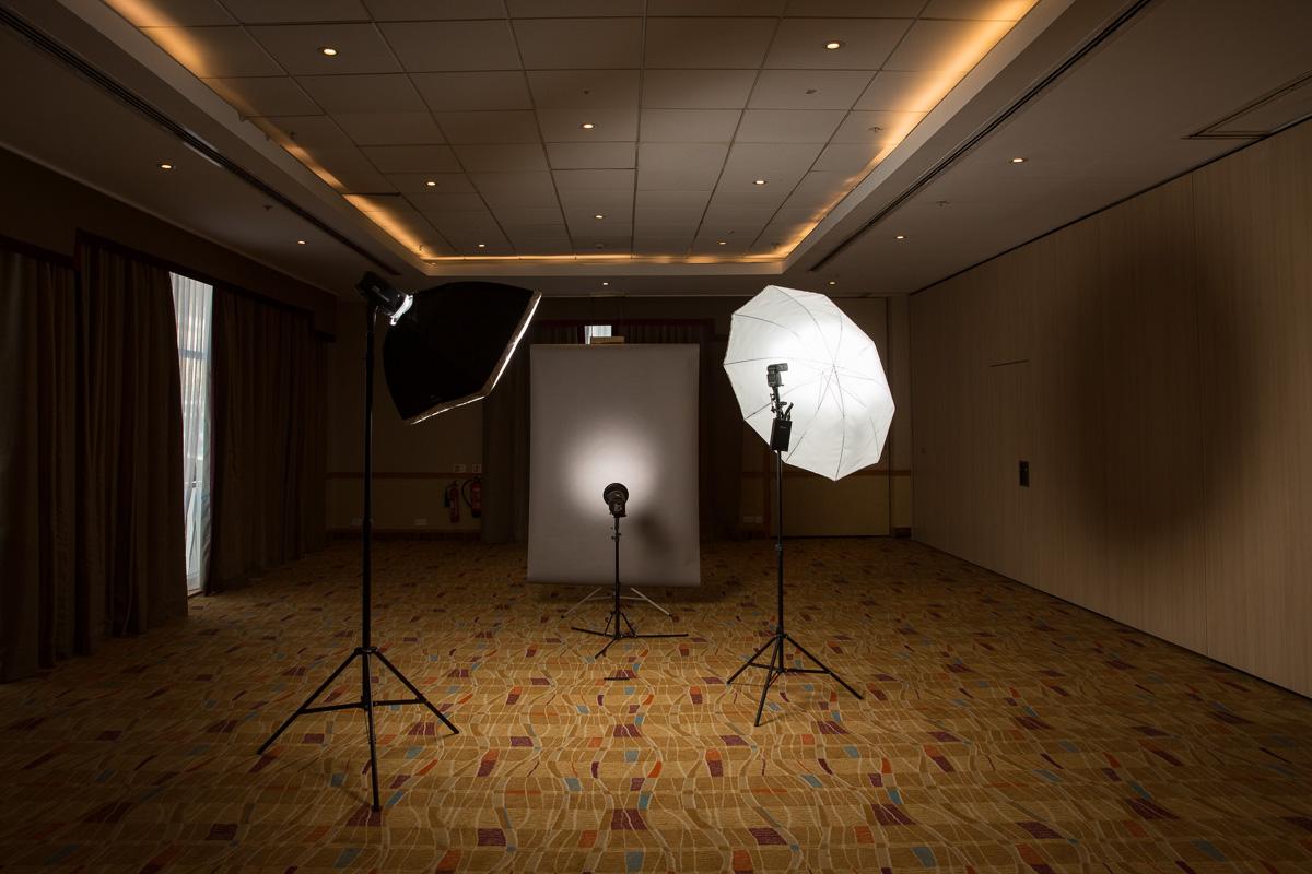 A portable photographic studio in a hotel ballroom.