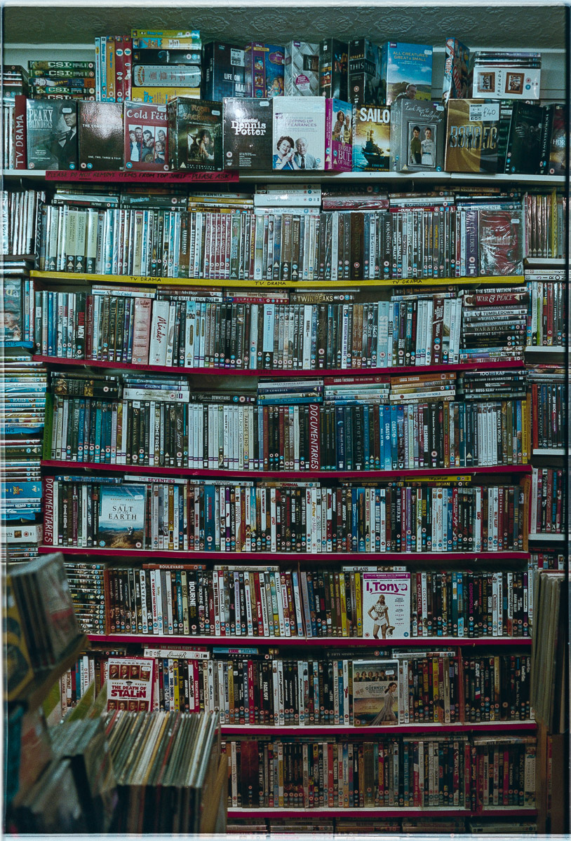Shelves of DVD stock bow under the weight.