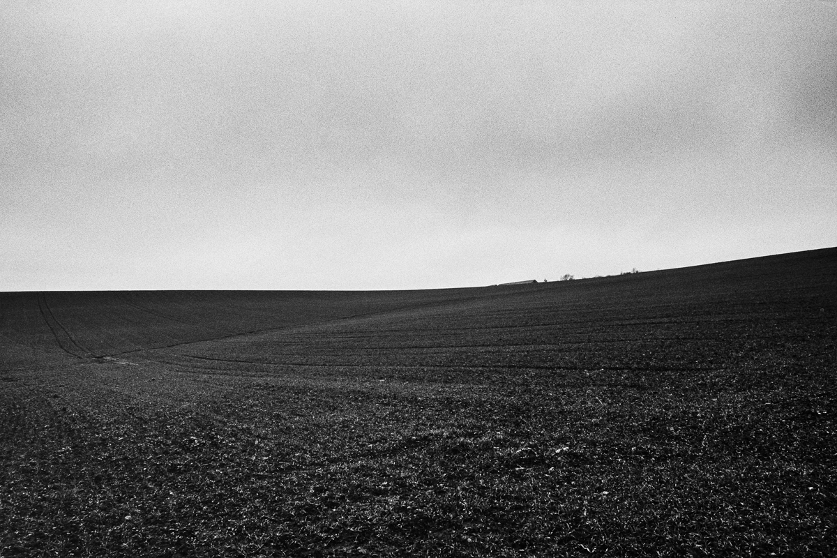 Black and white landscape of a ploughed field.