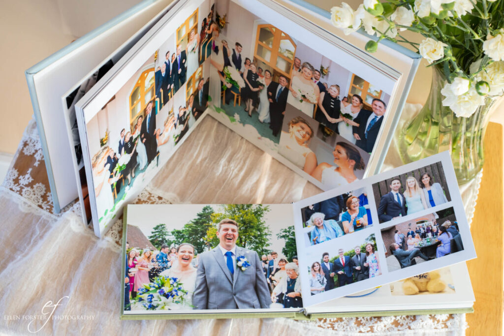 Two wedding albums with candid shots of the walk down the aisle and confetti shots.