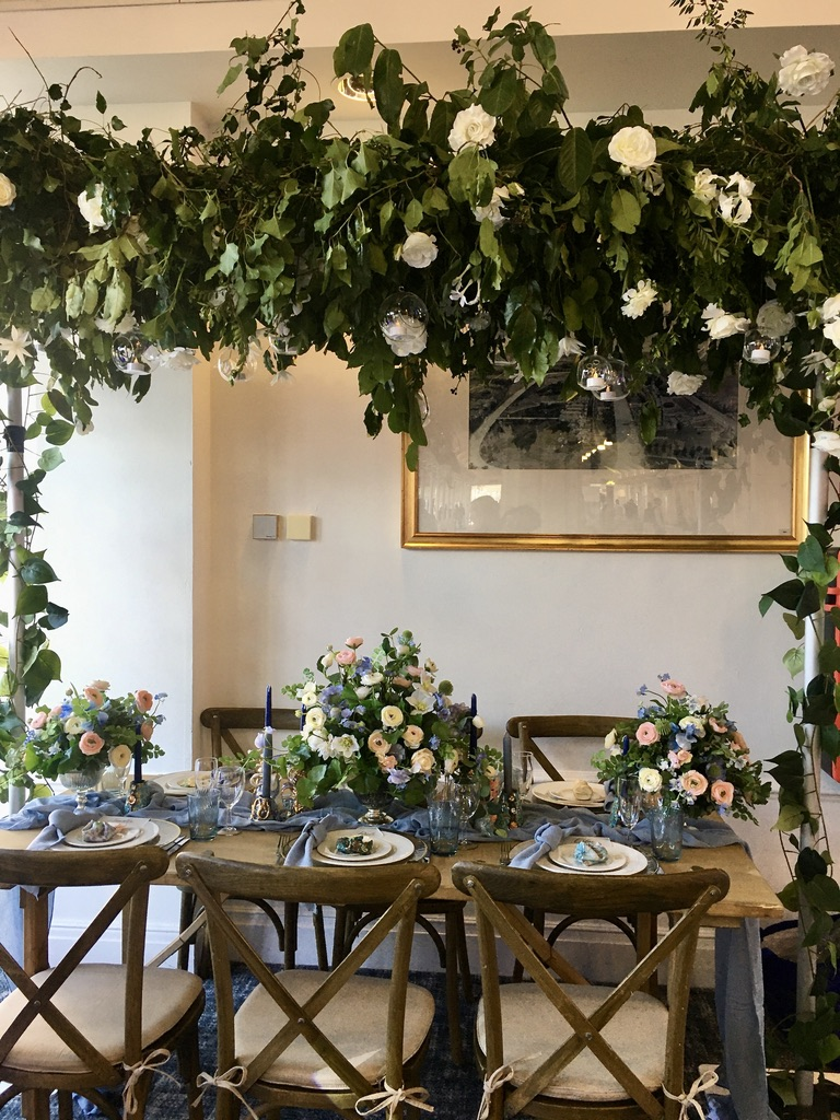 Botanical themed centrepiece and hanging foliage canopy by Fabulous Fucntions UK, with photography by Steffen Milsom Photography