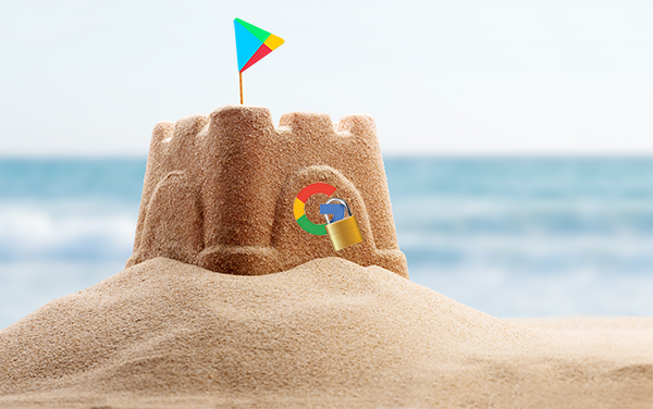 A sandcastle with a Google logo and lock