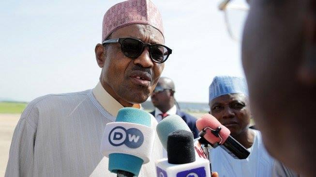 Photo of President Buhari Challenges Media Reporter To Wrestling