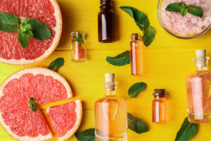 Aroma oil with citrus on yellow background