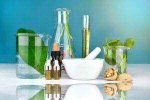 Natural organic medicine and healthcare, Alternative plant medicine, Mortar and herbal extraction in laboratory glassware.