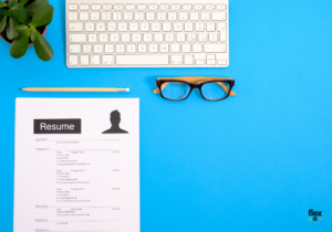 photo of keyboard and Resume on a desk