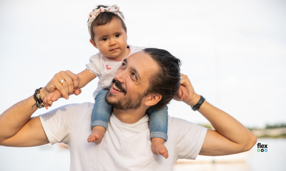 photo of dad with baby on his shoulders