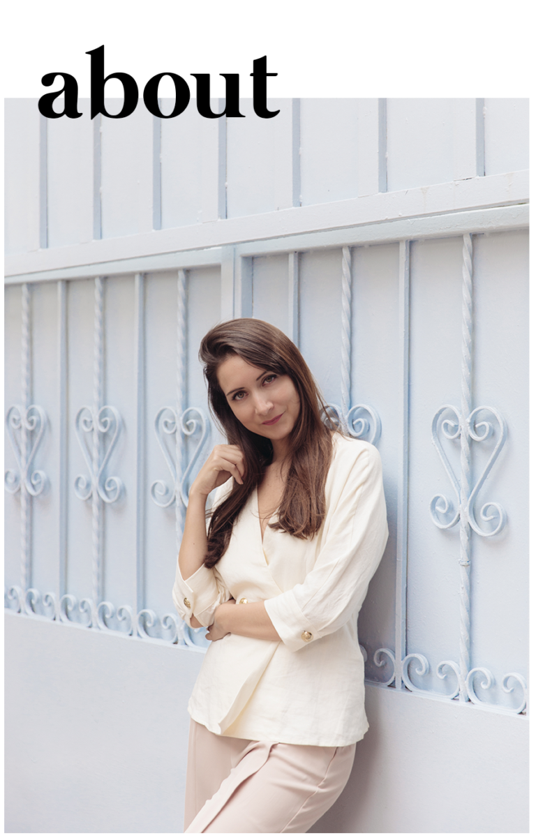 Maria Marie designer and photographer against a pastel wall