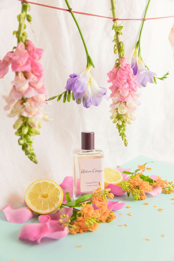 Creative photography and styling for Atelier Cologne in colorful pastel flowers