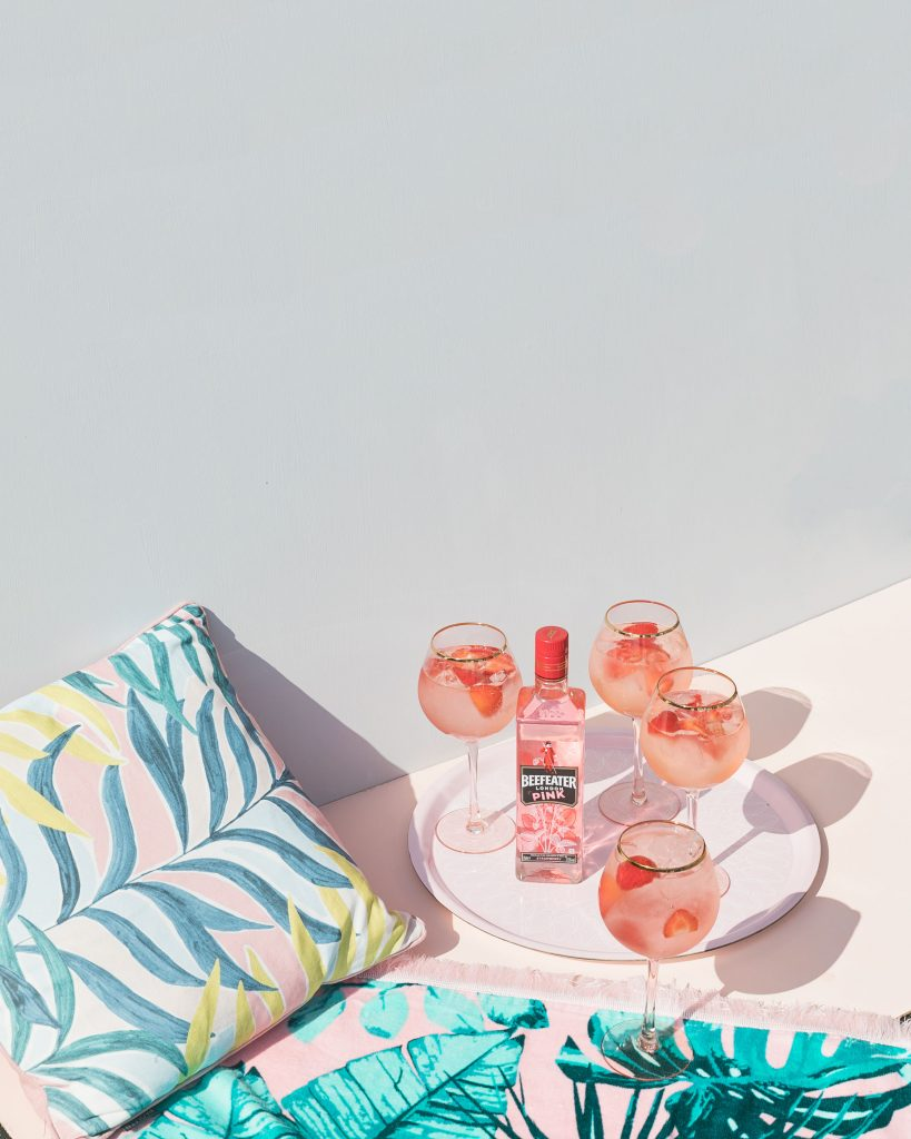 Creative summer photography and styling for pink beefeater gin