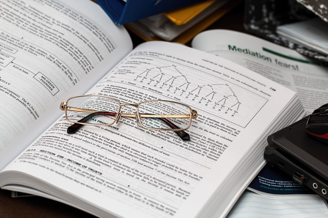 Textbook and glasses