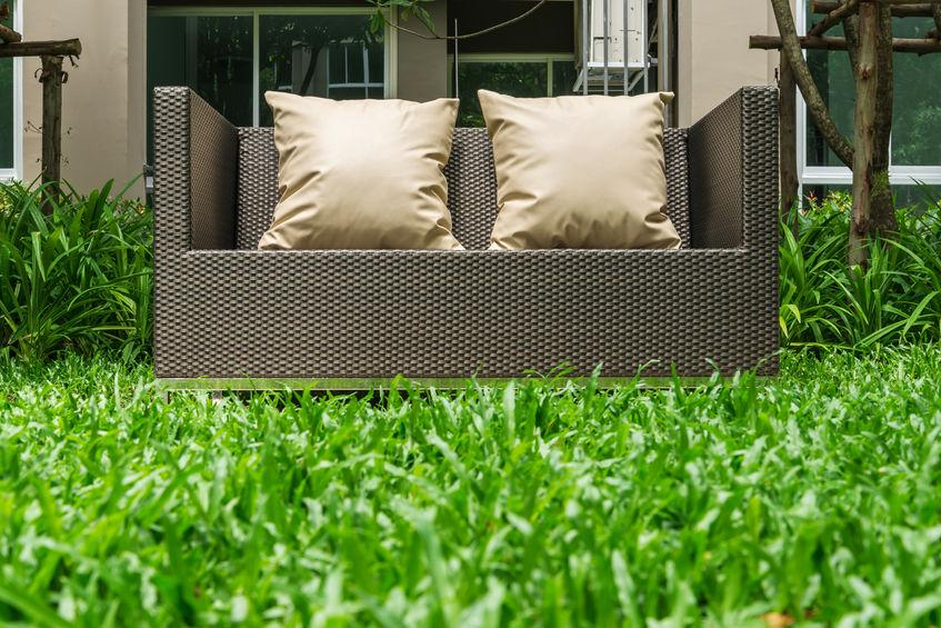 """Rattan furniture is often advertised as being weatherproof or at least weather resistant. This furniture is durable, even when buying bargain-priced examples. It has properties that prevent it from suffering the same deterioration that other types of furniture do. You're considering rattan furniture for its durability and ability to resist sun, wind, rain, and more. Is all rattan furniture weatherproof? Let's dive into the details and answer the question… Only Synthetic Rattan Furniture is """"Weatherproof"""" When asking the question """"Is all rattan furniture weatherproof?"""" it's important to make a distinction. Rattan is a type of palm that grows in East Asia. It was traditionally used to make wicker furniture. Modern wicker furniture, even when advertised as being made from rattan, isn't made from natural fibers. Instead, the rattan material we use today is made from polyethylene (PE), a durable plastic that is impervious to most weather effects. So, if we are considering mainstream furniture sold today, then all rattan furniture is synthetic. But is all rattan furniture weatherproof? Here are some important facts about synthetic rattan: • The synthetic PE rattan furniture that you can buy today is made of a plastic material that is impervious to moisture. • Humidity in the air won't degrade the wicker weave. • Snow won't damage synthetic rattan. • Rattan resists damage from hail because it is flexible in nature. • Synthetic rattan resists damage from direct heat and sunlight. • Rattan made from synthetic strands is safe in sub-zero temperatures. When considering all of this, rattan is extremely weather resistant, but it's not completely weatherproof. The frames used to make furniture are typically made from coated steel. Frames will resist damage from temperature extremes and moisture but can eventually rust. You can expect quality rattan furniture to last for at least five years. The best furniture will last much longer. Rattan won't discolor in the same way that natur"""