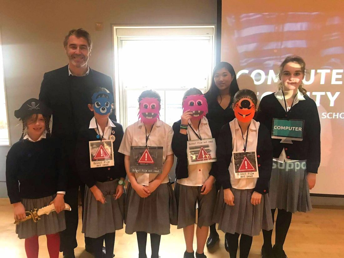 Students wearing masks celebrating Computer Security Day
