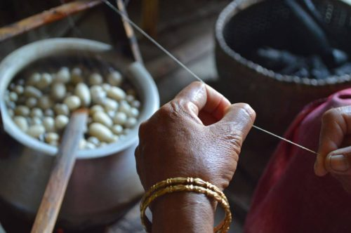 Kharey chingba: Traditional method of silk thread extraction. PC - Khumanthem FB page