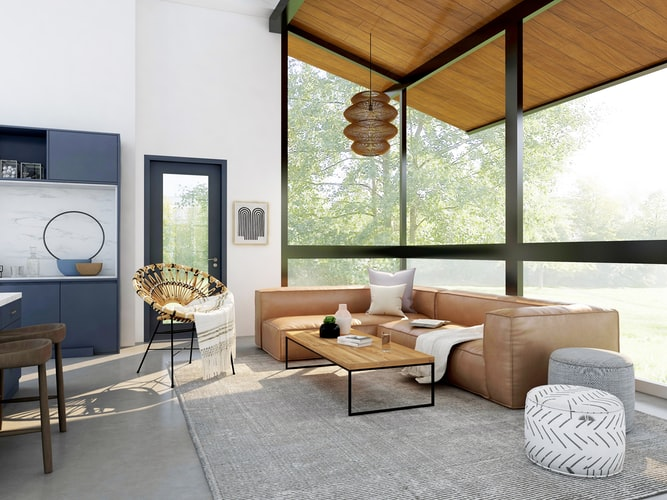 Bright living room with large windows that blends the outside inside harmoniously