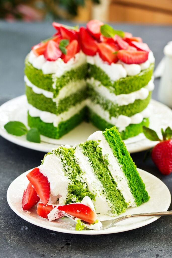 Fresh pistachio and strawberries Valentines Day cake decorating