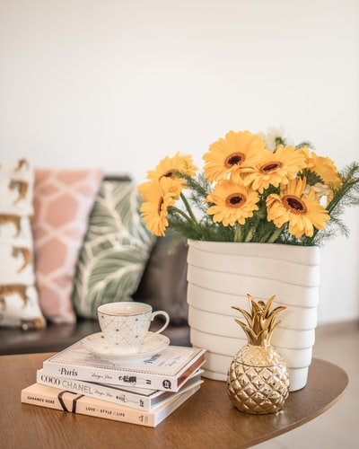 Gorgeous artificial yellow flowers in ceramic vase