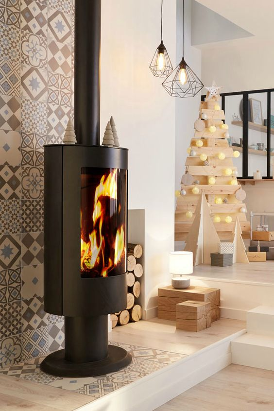 Iconic living room with fireplace and wood Christmas tree decoration