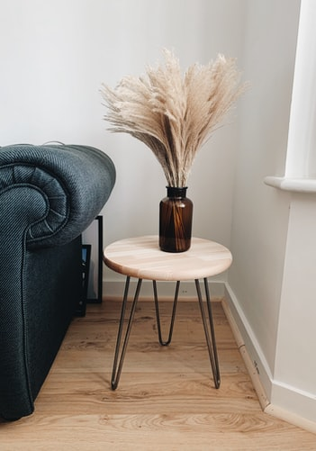 In a brown vase on top of coffee table and you can upgrade the look by adding a few scented candles too