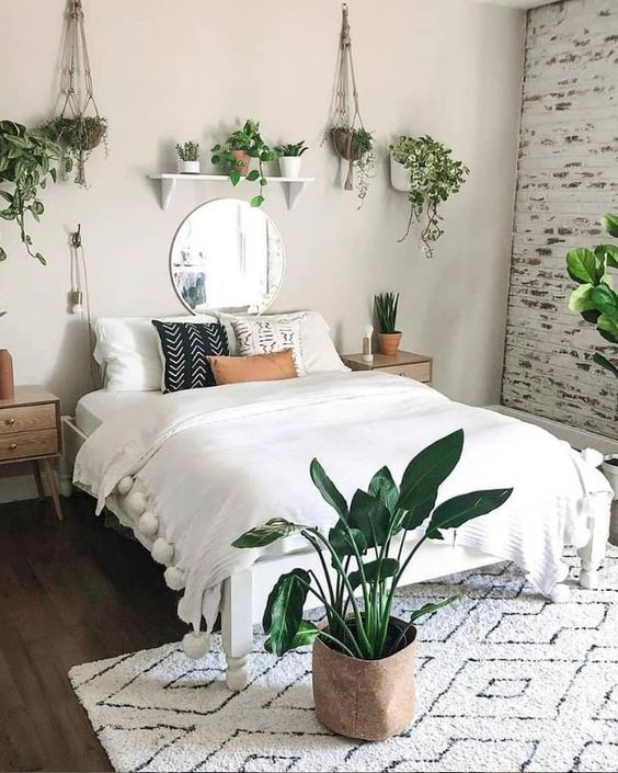 Boho bedroom decor surrounded by plants