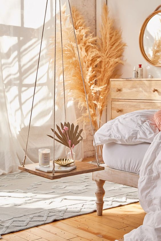 A relaxing bedroom décor with swing chair and pampas grass