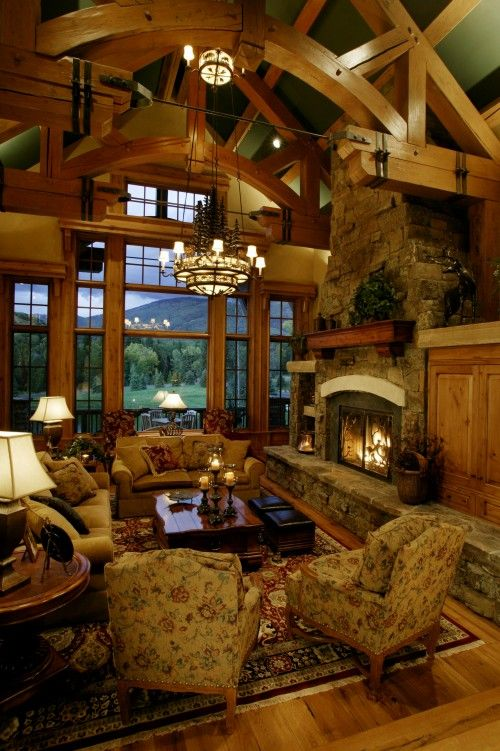 Mountain cabin with glass windows and  view towards landscape