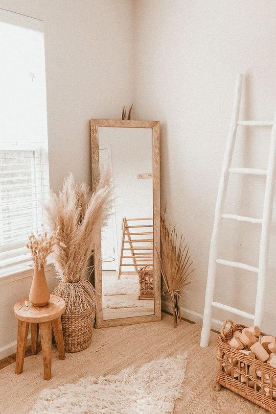 Recreate this bohemian bedroom decor by adding pampas grass in a large vase