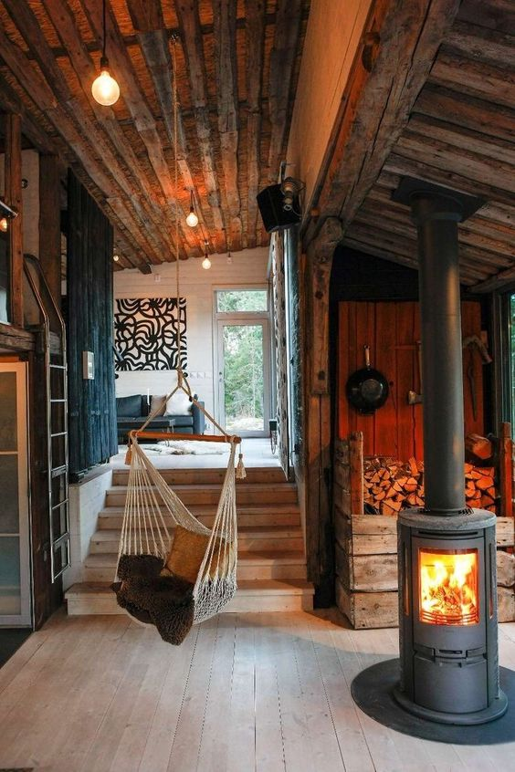Rustic log cabin with hammock chair and fireplace